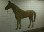Gilded subway mosaic.